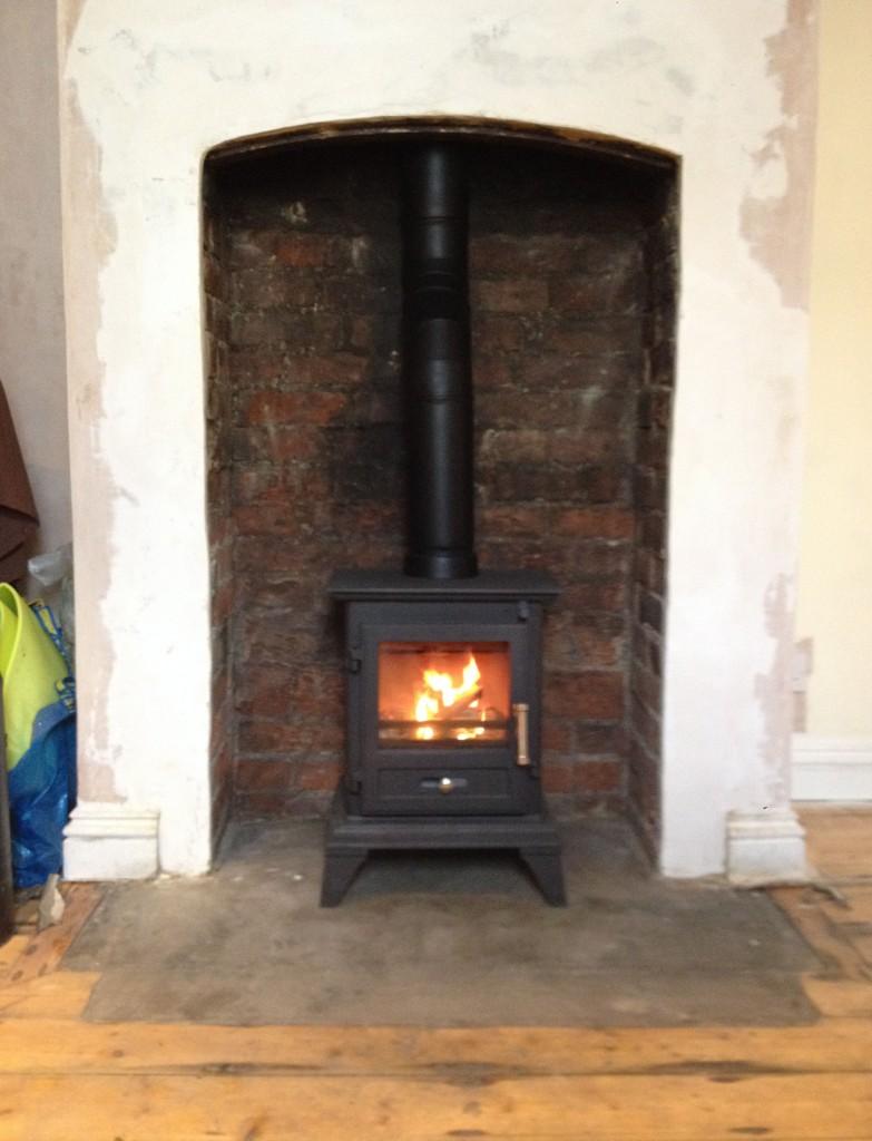Traditional Log Burner In Brick Fireplace Farnborough