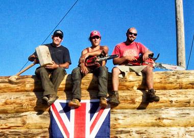 FireBug team building a log house in Canada