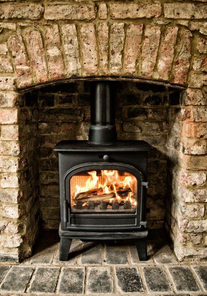 Parkray wood burner with brick hearth