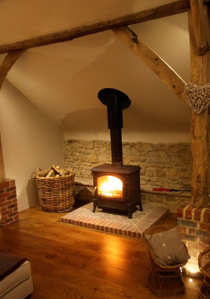 wood burning stove with herringbone brick hearth