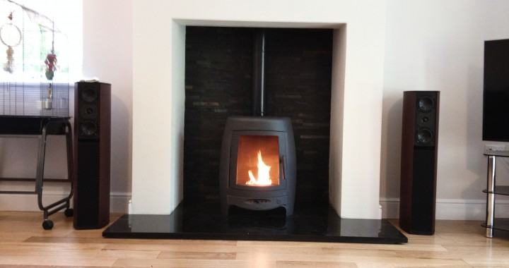 Modern wood burning stove Installation with split slate tiles and granite hearth