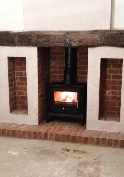 brick fireplace with wood burning stove Farnham
