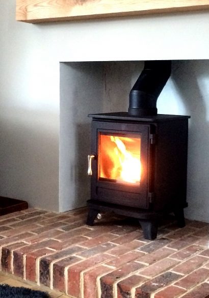 wood burning stove with brick hearth Farnborough