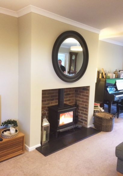 wood burning stove with custom build chimney breast