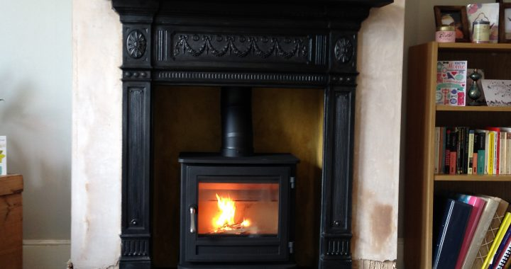 Reclaimed cast iron surround with wood burning stove