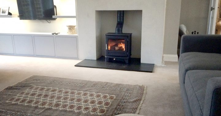 False chimney breast with twinwall flue and wood burning stove