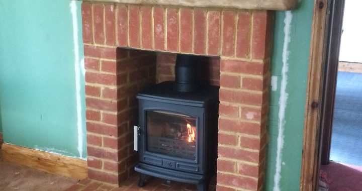 wood burning stove with brick surround, Alton