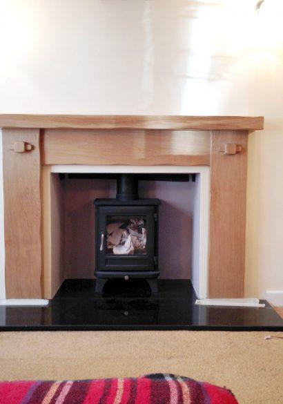 wood burning stove with oak surround fourmarks
