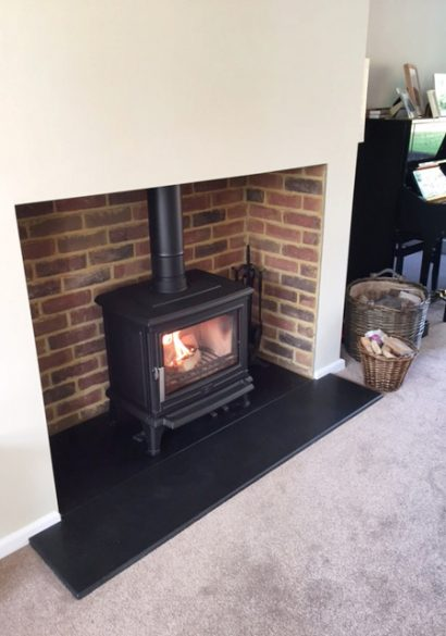 wood burning stove with brick fireplace Farnham