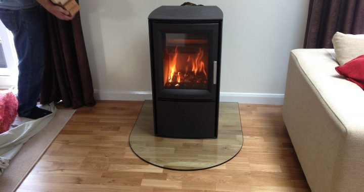 wood burning stove on glass hearth