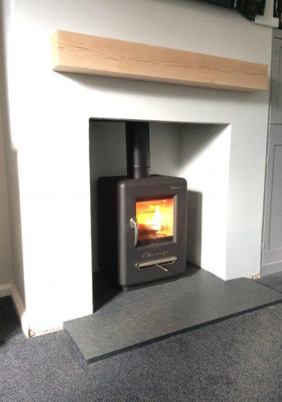 wood burning stove with river wash granite hearth