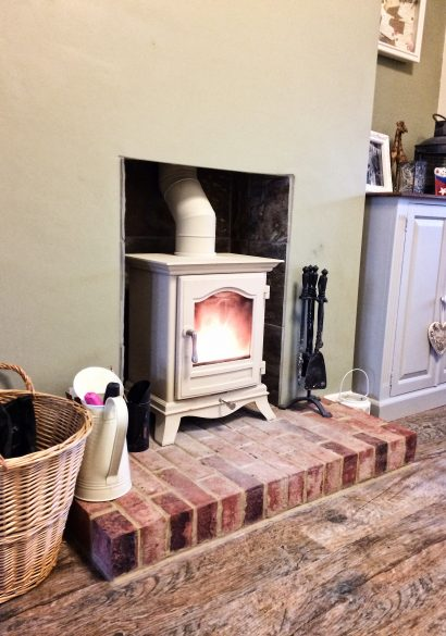 Chesney's wood burning stove in parchment finish