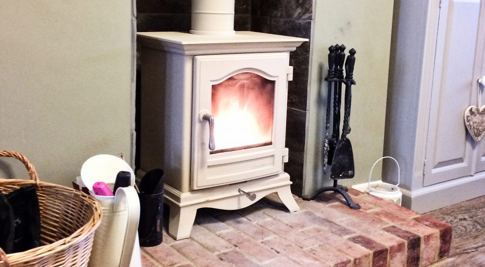 Coloured wood burning stove installation Aldershot