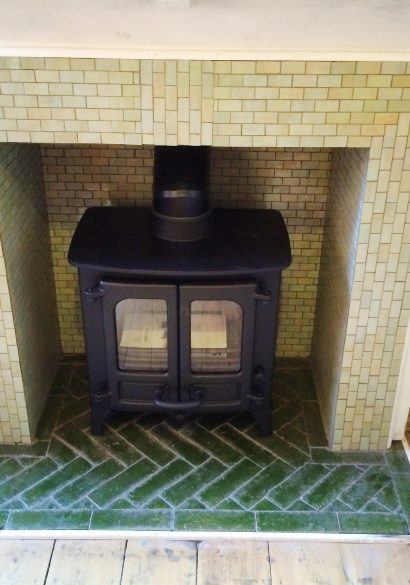 wood burning stove with tiled hearth and surround