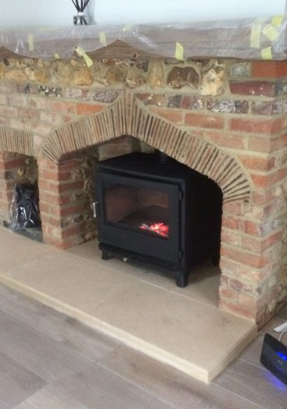 bath stone hearth with large wood burner