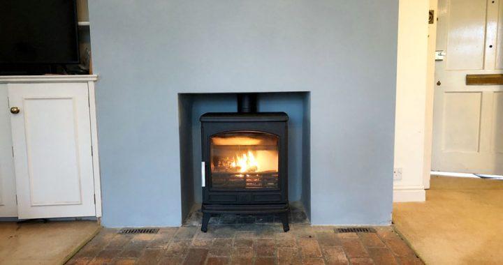 large cast multi fuel stove with brick hearth