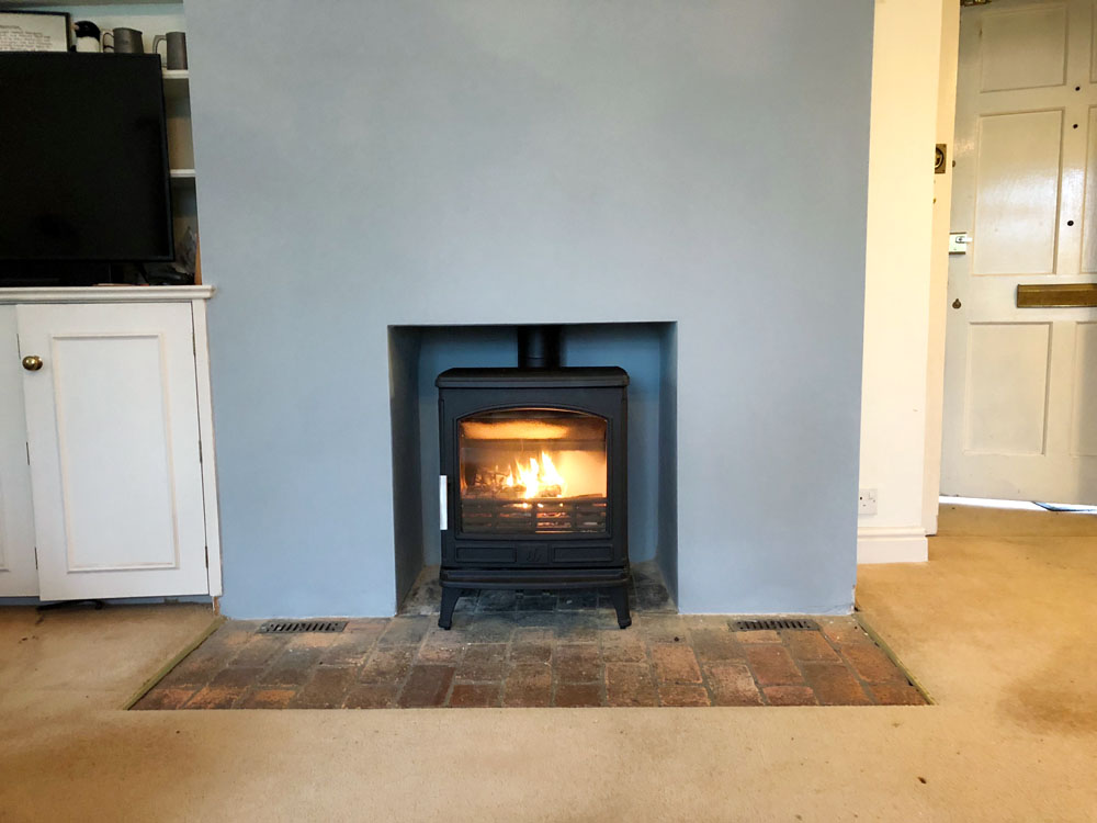 large cast multi fuel stove with brick hearth