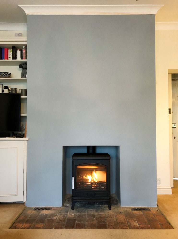 cast iron multifuel stove on a brick hearth