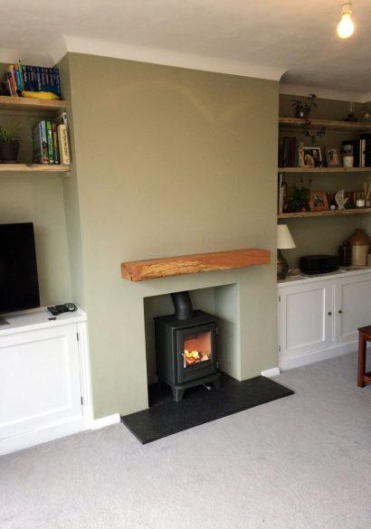 log burner with granite hearth and oak mantle