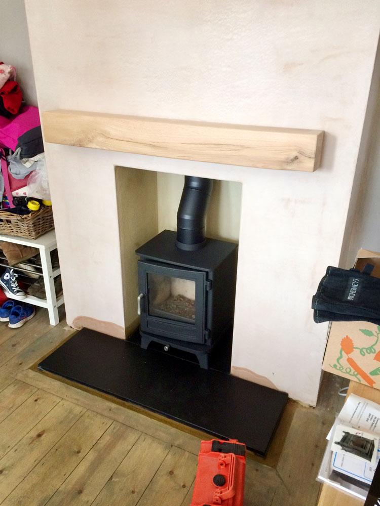 wood burner with oak floating mantlepiece