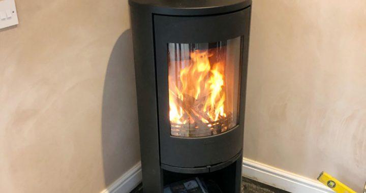Corner log burner in new extension