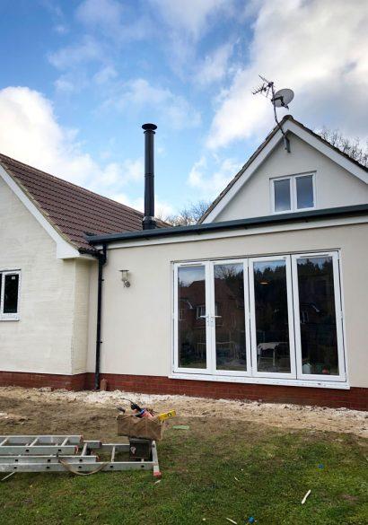 External twinwall flue exiting flat roof