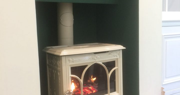 cream enamel log burner with rustic mantle piece