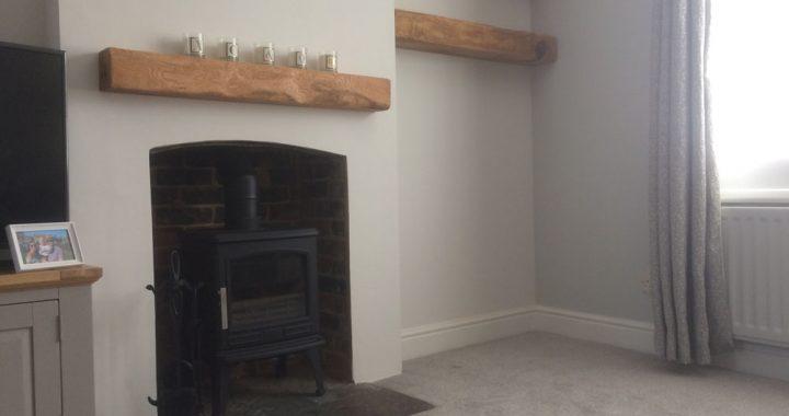 log burner with oak mantle and matching shelves