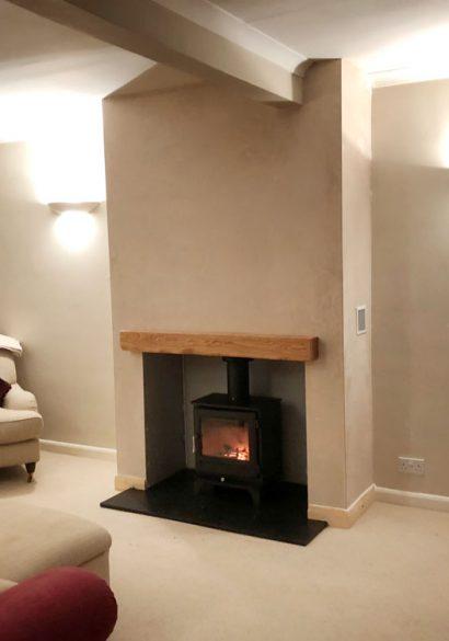 wood burner with granite hearth and oak mantle