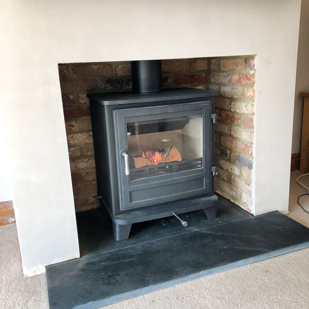 salisbury 8 stove with brick fireplace
