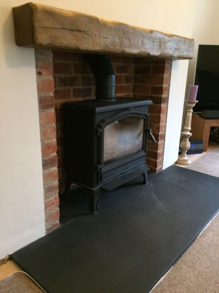 log burner with non combustible mantle piece