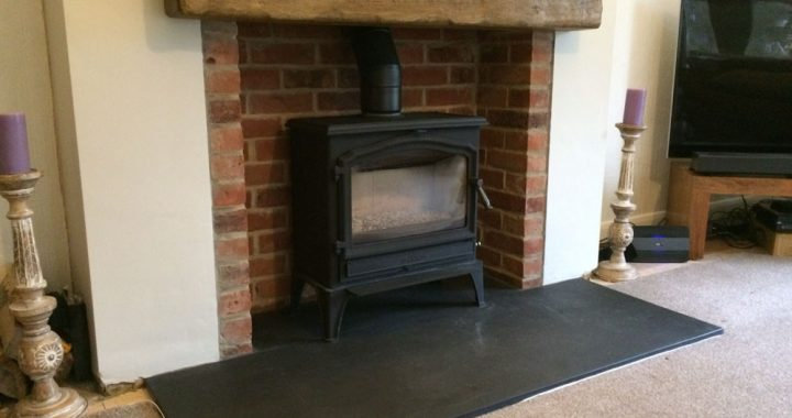 traditional wood burner with non combustible mantle