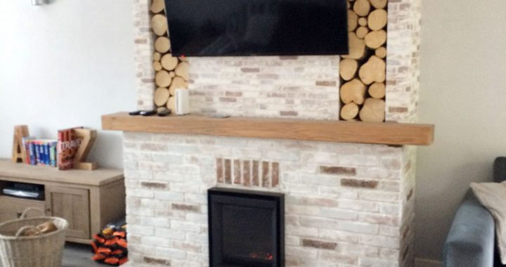 Stuv Inset wood burner with brick fireplace