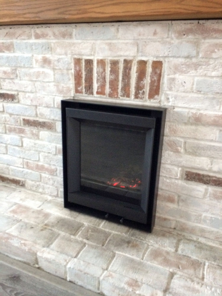 Stuv Inset wood burner with brick hearth
