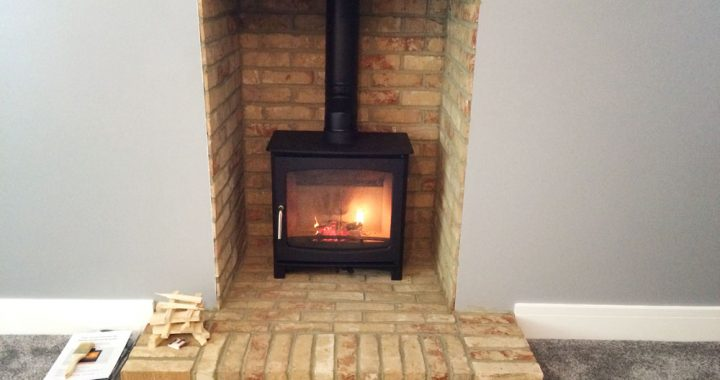 log burner with brick slip fireplace