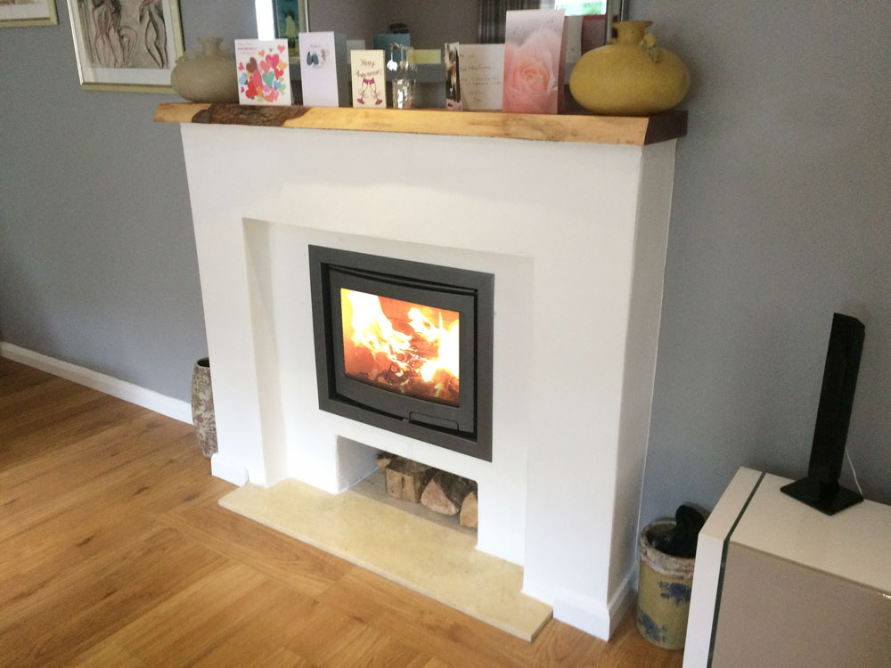 modern fireplace surround with inset log burner