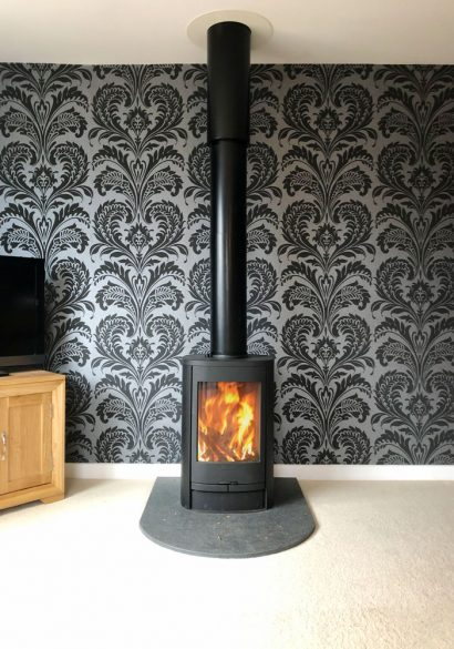 freestanding wood burner with round hearth