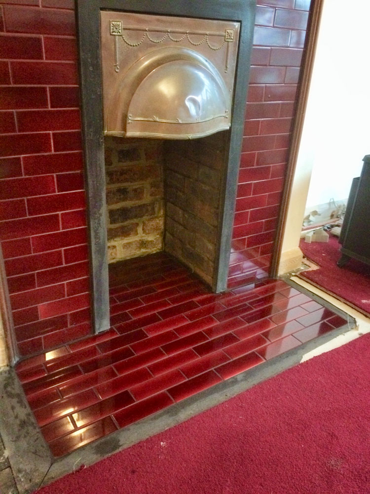tiled fireplace with log burner