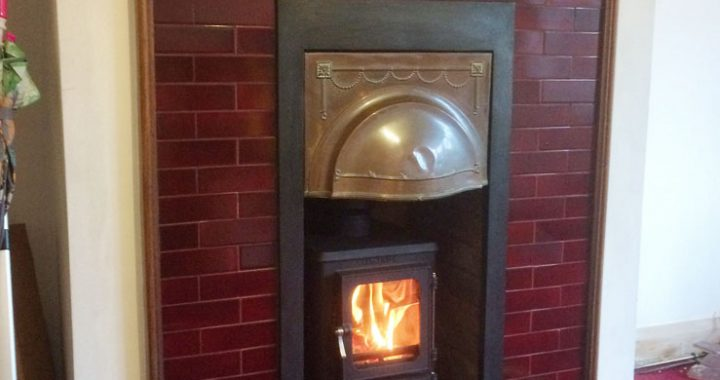 Edwardian tiles fireplace with log burner