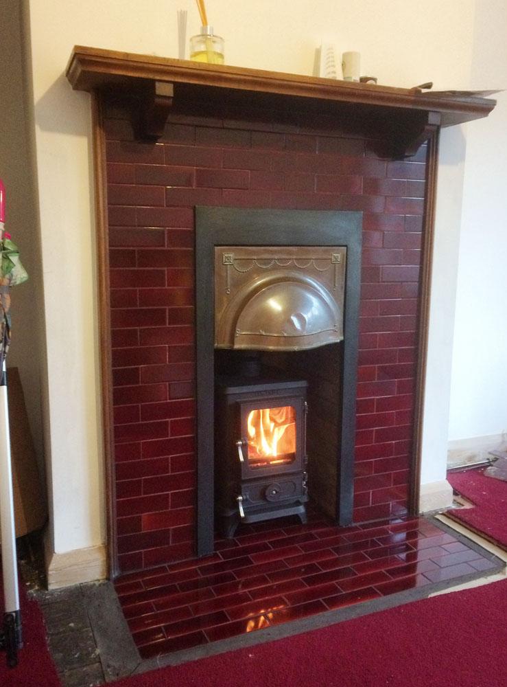 Edwardian tiles fireplace with log burner